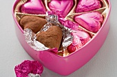 Pink chocolates in heart-shaped box
