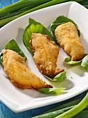 Deep-fried fish fillets on basil