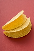 Two taco shells on red background