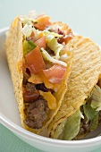 Two mince tacos in white dish (close-up)