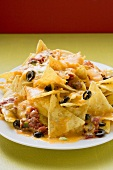 Nachos with melted cheese and olives (Mexico)