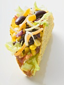 Taco filled with beans and sweetcorn