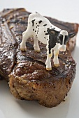 Grilled T-bone steak with toy calf