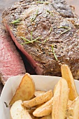Sirloin steak with potato wedges (close-up)