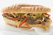 Steak sandwich with peppers and cheese
