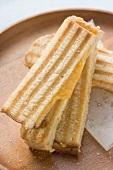 Cheese toasties on round wooden tray