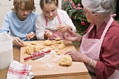 Grandmother and grandchildren making vanilla crescents