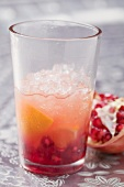 Fruity drink with orange and pomegranate