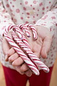 Woman holding candy canes