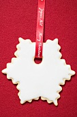 White star biscuit to hang on the Christmas tree
