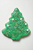 Christmas tree biscuit decorated with hundreds & thousands