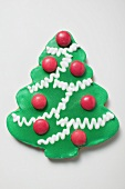Christmas tree biscuit decorated with chocolate beans