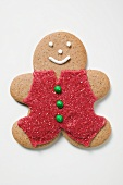 Gingerbread man decorated with red sugar