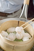 Cooking dim sum in bamboo steamer