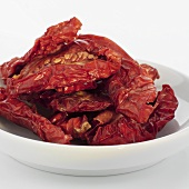 Organic dried tomatoes in white dish