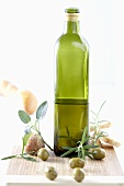 Bottle of olive oil, herbs, olives and white bread