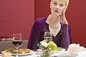 Bored woman waiting for her partner at table