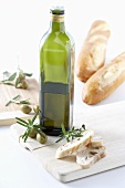 Bottle of olive oil, rosemary and bread