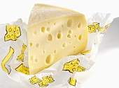 Piece of Emmental cheese in paper
