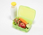 Healthy lunch box and bottle of milk
