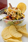 Mexican salad with tortilla chips to take away