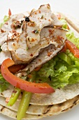 Grilled tortillas with chicken and peppers