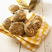 Mixed seed bread rolls on a checked cloth