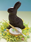 Chocolate Bunny, jelly beans, cookie, paintbrush in Easter nest