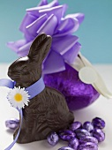 Chocolate Bunny and chocolate Easter eggs in purple foil