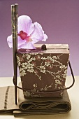 Asian container, orchid and chopsticks