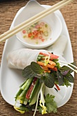 Rice paper roll with vegetable filling and chilli sauce