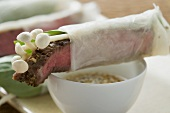 Rice paper rolls filled with beef & mushrooms, sesame sauce