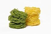 Green and yellow ribbon pasta nests