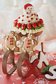 Cupcake and gingerbread men on small sleigh