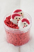 Father Christmases and red sugar stars in a jar