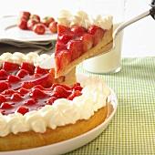 Strawberry flan with cream, a piece cut