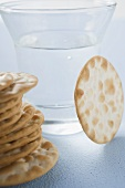 Several crackers in front of a schnapps glass