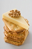 Piece of Emmental cheese with walnut on crackers