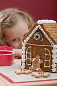 Gingerbread house, small girl in background