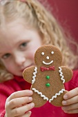 Small girl holding gingerbread man
