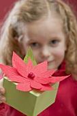 Small girl holding Christmas gift