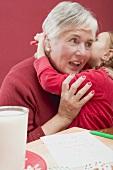 Small girl embracing grandmother