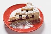Piece of Linzer Torte with icing sugar on plate (Austria)
