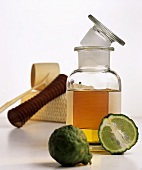 Bergamot oil in bottle, massage equipment, kaffir lime