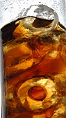 Glass of cola with ice cubes (close-up)