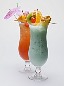 Two Caribbean long drinks with fruit skewers
