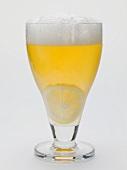 Glass of shandy with slice of lemon (UK)