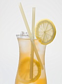 Iced tea with lemon slices and straws