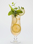 Glass of iced tea with lemon slices and fresh mint