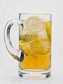 Iced tea with lemon slices in glass jug